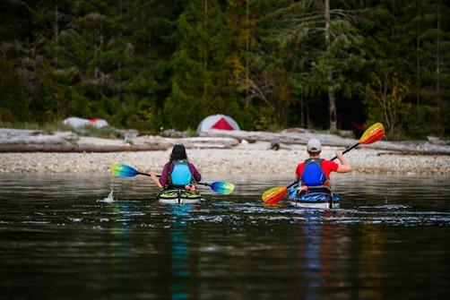 Kayaking back to camp on Sechelt Inlet, Sunshine Coast, British Columbia.
