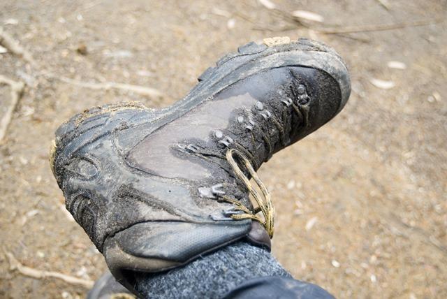 muddy walking boot